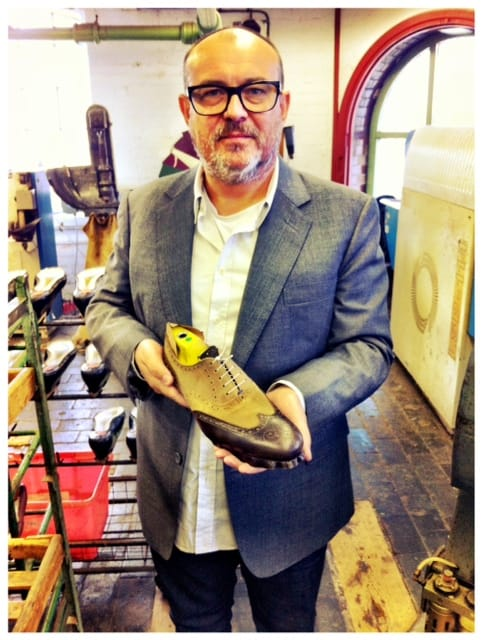 Tim Little - Owner & Creative Director holds a pair of the Grenson x Stuarts London Collaboration style