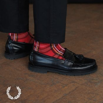 Black leather loafers with tartan socks