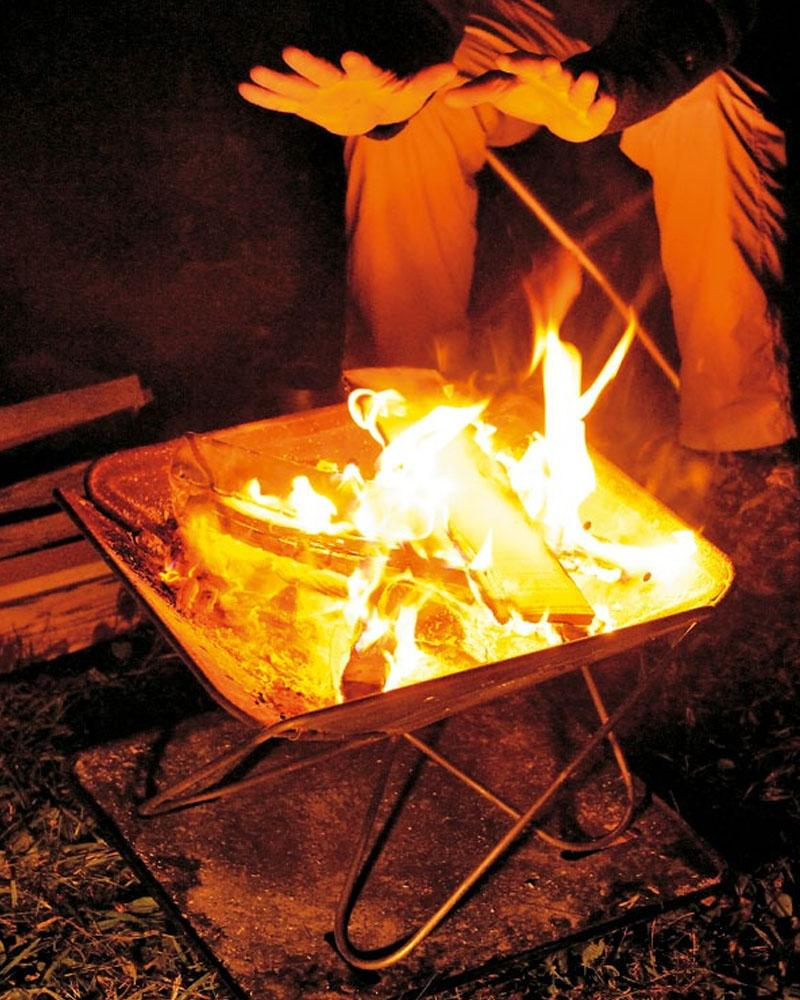 Camp fire with open flame