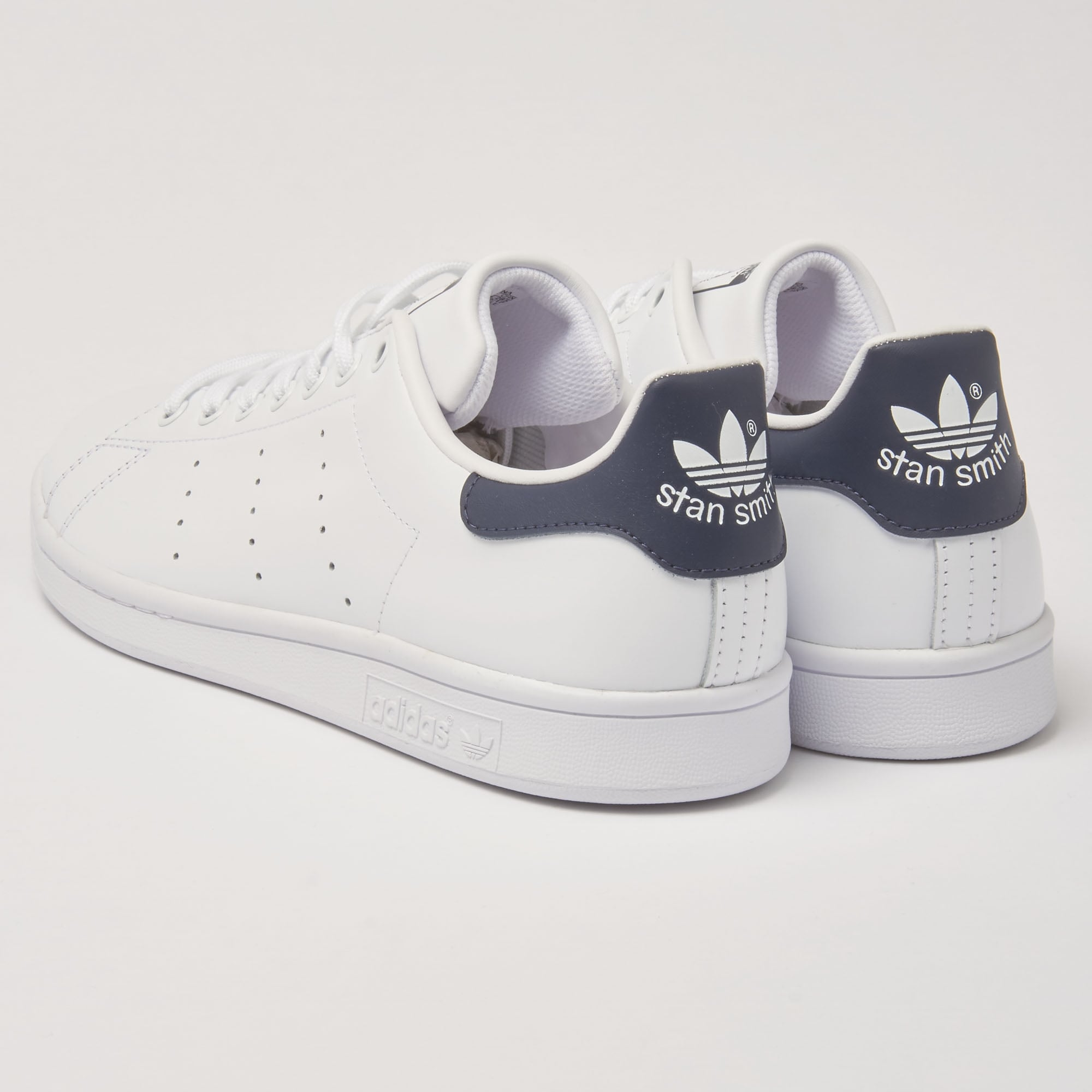 separation shoes 18810 395e5 White   Navy Stan Smiths Sneakers